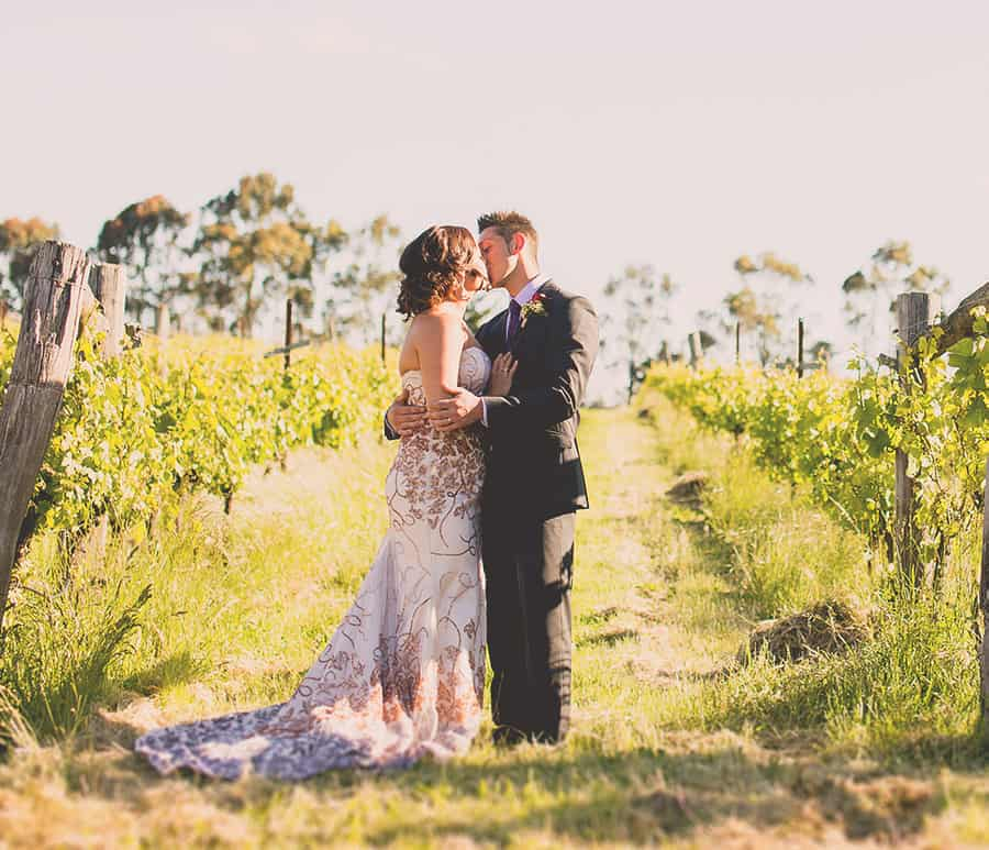 Romantic wedding kiss in the vines, Captain's Creek Winery