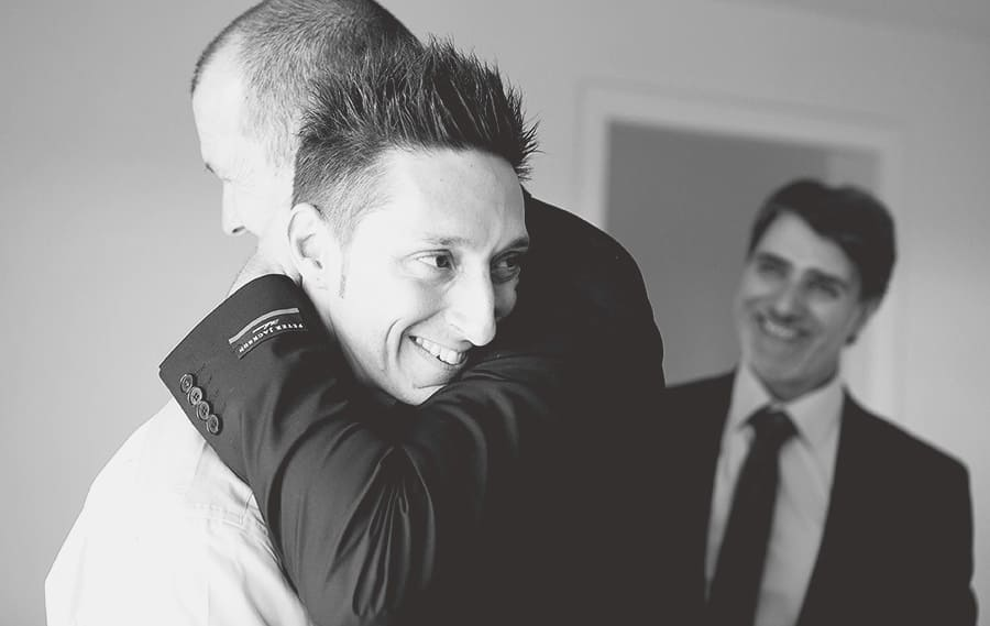 Best man giving heartwarming hug before leaving to Daylesford Wedding