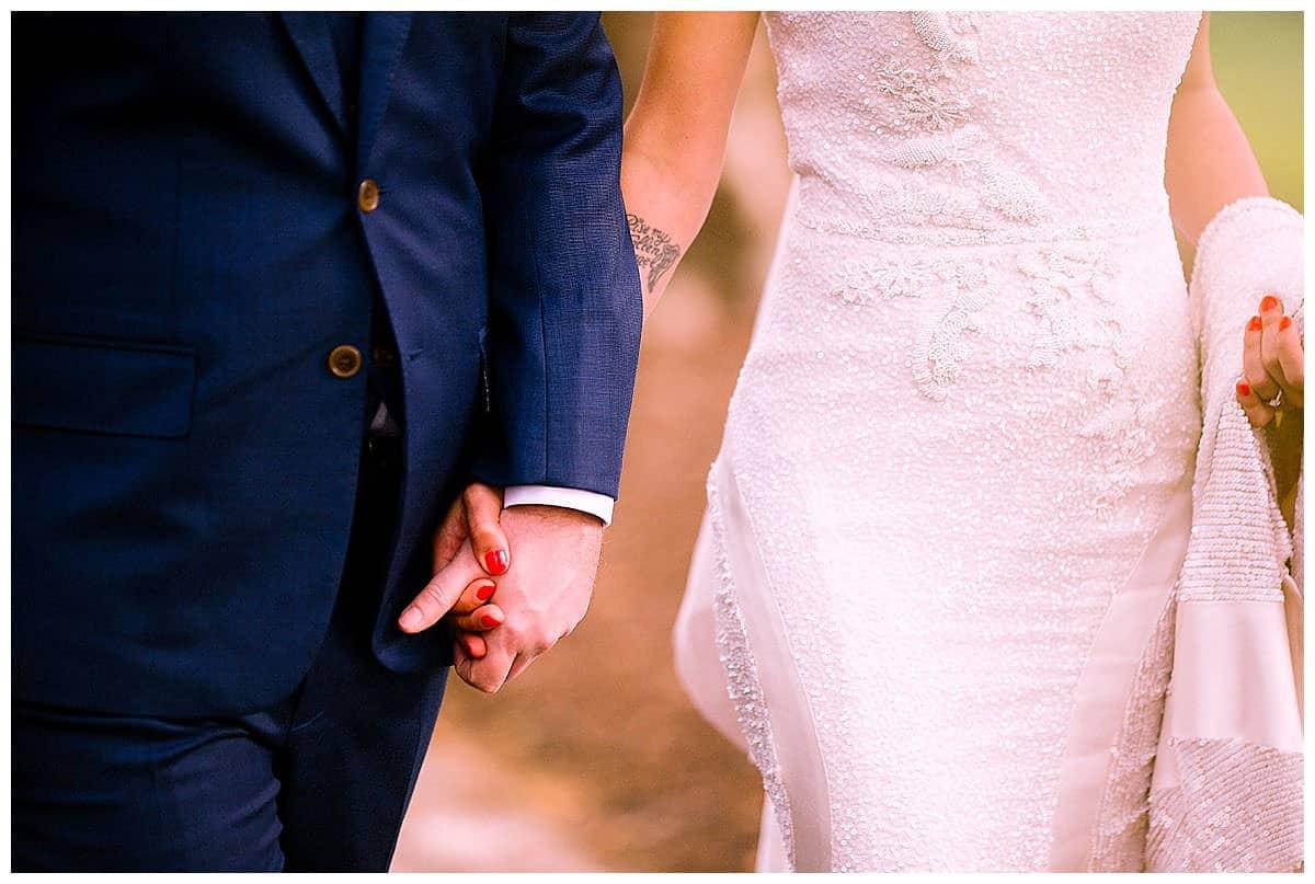 Wedding couple Davor & Natasa holding hands in Melbourne Gardens