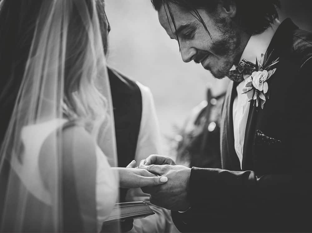 Mansfield Wedding Ceremony - Groom putting ring on Brides finger